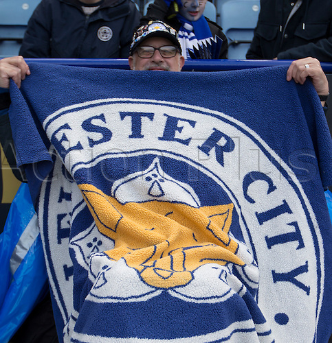 24.04.2016. King Power Stadium, Leicester, England. Barclays Premier League. Leicester versus Swansea.  A disabled Leicester City Football Club supporter wrapped in a large blanket displaying the club emblem.