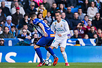 Lucas Vazquez (R) of Real Madrid fights for the ball with Ruben Duarte of Deportivo Alaves during the La Liga 2017-18 match between Real Madrid and Deportivo Alaves at Santiago Bernabeu Stadium on February 24 2018 in Madrid, Spain. Photo by Diego Souto / Power Sport Images