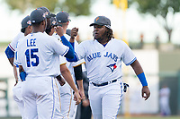 AFL West third baseman Vladimir Guerrero Jr. (27), of the Surprise Saguaros and Toronto Blue Jays organization, fist bumps with teammates, including Khalil Lee (15), during player introductions before the Arizona Fall League Fall Stars game at Surprise Stadium on November 3, 2018 in Surprise, Arizona. The AFL West defeated the AFL East 7-6 . (Zachary Lucy/Four Seam Images)