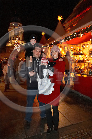 """BERLIN - GERMANY 04. DECEMBER 2006 -- Weihachts Zauber Gendarmenmarkt - Christmas Attraction - Christmas Market at Gendarmen Market - Family Pruemer, mother Natascha, 35, father Thomas, 32, the 5 year old son Poul and four month old Ann -- PHOTO: CHRISTIAN T. JOERGENSEN / EUP & IMAGES..This image is delivered according to terms set out in """"Terms - Prices & Terms"""". (Please see www.eup-images.com for more details)"""