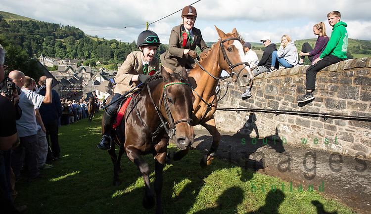 Langholm Common Riding 2016. Crowds watching as horses charge up Kirk Wynd