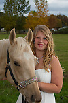 Young horse enthusiast poses with her horse.