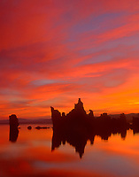 761950004 sunrise turns the clouds pink and red and reflects in mono lake with tufas at south tufa beach on mono lake state natural reserve in north central california