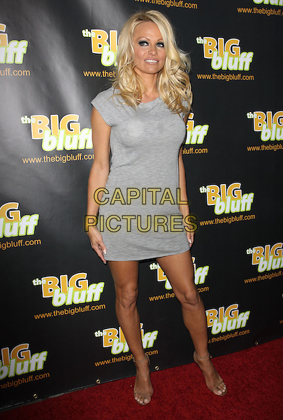 PAMELA ANDERSON.The Big Bluff Online Triva Game Launch Hosted By Perez Hilton held At Industry, West Hollywood, California, USA..May 24th, 2010.full length grey gray sleeveless dress sandals mini.CAP/ADM/KB.©Kevan Brooks/AdMedia/Capital Pictures.