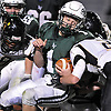 Locust Valley No. 1 John Pedranghelu fights for yards during a Nassau County varsity football Conference IV semifinal against West Hempstead at Hofstra University on Thursday, Nov. 12, 2015. Locust Valley won 34-10.<br /> <br /> James Escher