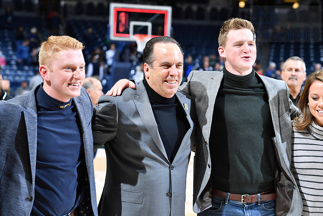 November 16, 2017; Head Men's Basketball coach Mike Brey sings the Alma Mater with students dressed in mock turtlenecks, worn as a wink to the mock turtlenecks which were once a staple of Brey's on-court apparel. (Photo by Matt Cashore/University of Notre Dame)