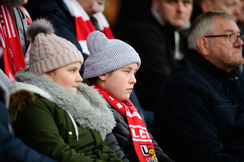 Lincoln City fans watch their team in action<br /> <br /> Photographer Chris Vaughan/CameraSport<br /> <br /> The EFL Sky Bet League Two - Lincoln City v Mansfield Town - Saturday 24th November 2018 - Sincil Bank - Lincoln<br /> <br /> World Copyright © 2018 CameraSport. All rights reserved. 43 Linden Ave. Countesthorpe. Leicester. England. LE8 5PG - Tel: +44 (0) 116 277 4147 - admin@camerasport.com - www.camerasport.com