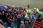 The New Saints 4 Bohemians 0, 20/07/2010. Park Hall Stadium, Champions League 2nd qualifying round 2nd leg. Supporters of Irish club Bohemians applaud their team onto the field at Park Hall Stadium, Oswestry before their team's Champions League 2nd qualifying round 2nd leg game away to The New Saints. Despite leading 1-0 from the first leg, the Dublin club went out following their 4-0 defeat by the Welsh champions. The match was the first-ever Champions League match in the UK played on an artificial pitch and was staged at the Welsh Premier League's ground which was located over the border in England. Photo by Colin McPherson.