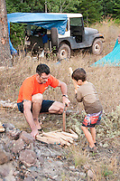 Joe Chmelar and his son Crew chop firewood at their camp at High Rock Bay on the Keweenaw Peninsula during the 2010 U.P. Overland trip in the Upper Peninsula of Michigan.