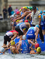 07 JUL 2012 - PARIS, FRA - Competitors climb onto the pontoon for the start of the elite men's French Grand Prix round during the 2012 Triathlon de Paris beside the Pont d'Lena, Paris, France .(PHOTO (C) 2012 NIGEL FARROW)