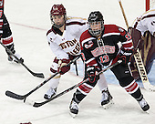 Emily Pfalzer (BC - 14), Claire Santostefano (NU - 13) - The Boston College Eagles defeated the Northeastern University Huskies 3-0 on Tuesday, February 11, 2014, to win the 2014 Beanpot championship at Kelley Rink in Conte Forum in Chestnut Hill, Massachusetts.