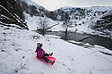 30/01/15<br /> <br /> Freya Kirkpatrick (7) sledges by the stepping stones at Dovedale after heavy overnight snowfall in the Derbyshire Peak District.<br /> <br /> All Rights Reserved - F Stop Press.  www.fstoppress.com. Tel: +44 (0)1335 418629 +44(0)7765 242650