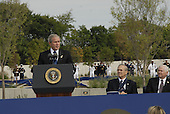 President George W. Bush speaks at the Pentagon Memorial dedication ceremony Sept. 11, 2008. The national memorial is the first to be dedicated to those killed at the Pentagon on Sept. 11, 2001. The site contains 184 inscribed memorial units honoring the 59 people aboard American Airlines Flight 77 and the 125 in the building who lost their lives that day. .Credit: Joseph Buzanowski - DoD via CNP