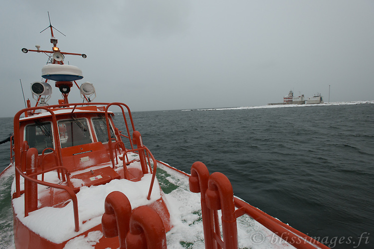 Pilot boat circles Märket Island before anchoring in the Åland Sea.