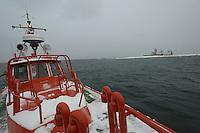 Pilot boat circles Märket Island before anchoring in the Åland Sea.