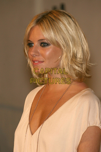 "SIENNA MILLER.SBIFF Opening Night - ""Factory Girl"" Premiere held at Arlington Theatre, Santa Barbara, California, USA..January 25th, 2007.headshot portrait smokey eyes eyeliner makeup make up make-up pimple spot nose.CAP/ADM/ZL.©Zach Lipp/AdMedia/Capital Pictures"
