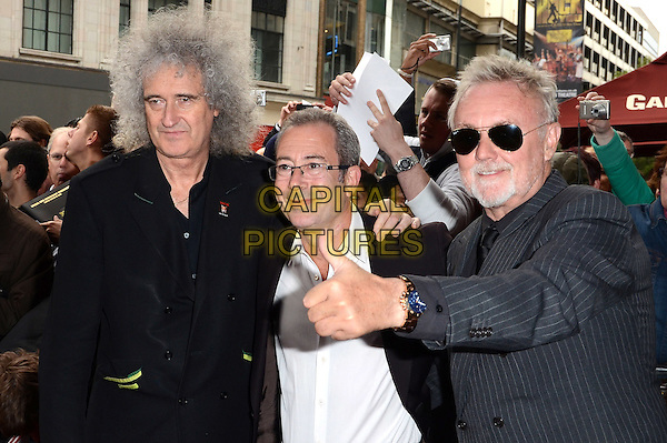 Brian May, Ben Elton and Roger Taylor.'We Will Rock You' 10th Anniversary Performance at the Dominion Theatre, Tottenham Court Road, London, England..May 14th 2012.half length black jacket white grey gray hand thumb up sunglasses shades glasses goatee facial hair pinstripe .CAP/ROS.©Steve Ross/Capital Pictures