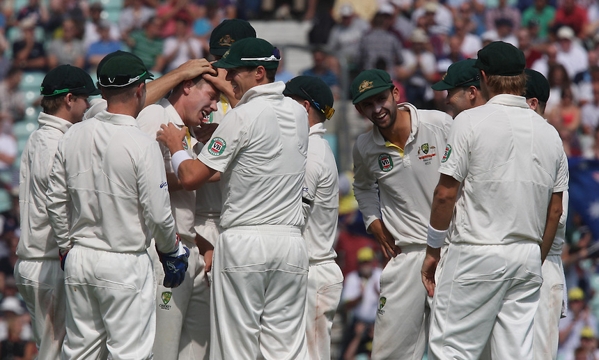 Australia's James Faulkner celebrates his first wicket in Test cricket <br /> <br /> Photo by Kieran Galvin / CameraSport<br /> <br /> International Cricket - Fifth Investec Ashes Test Match - England v Australia - Day 5 - Thursday 25th August 2013 - The Kia Oval - London<br /> <br /> &copy; CameraSport - 43 Linden Ave. Countesthorpe. Leicester. England. LE8 5PG - Tel: +44 (0) 116 277 4147 - admin@camerasport.com - www.camerasport.com