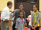 "United States President Barack Obama and daughters Malia and Sasha sign ""Happy Birthday"" to First Lady Michelle Obama on her birthday on Monday, January 17, 2011 as the first family participates in a community service event at the Stuart Hobson Middle School Service Project in Washington, D.C.  to honor the birthday of Dr. Martin Luther King Jr.  .Credit: Dennis Brack / Pool via CNP"