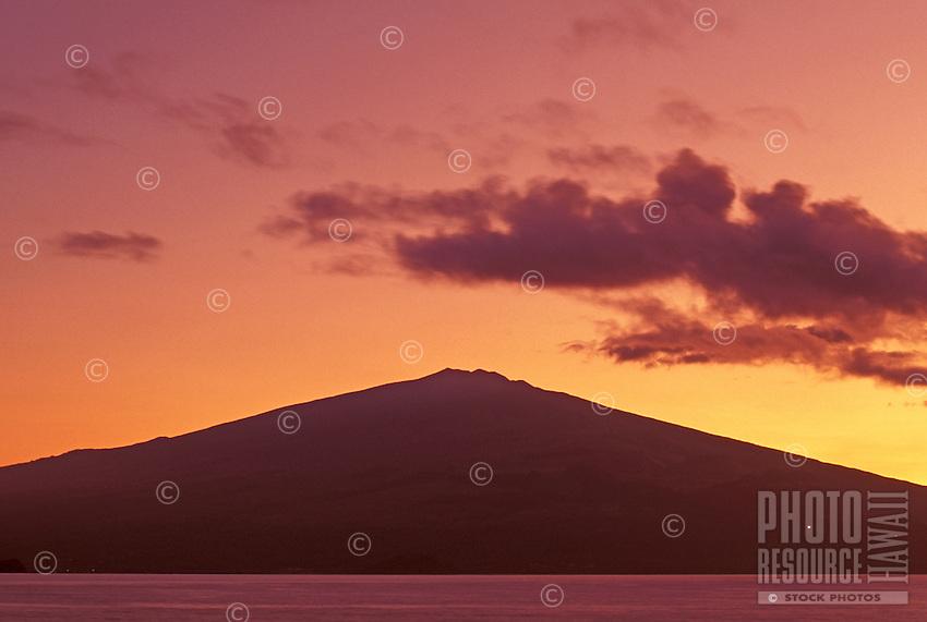 Beautiful sunset over Haleakala (House of the Sun) mountain on Maui, shot from the shore on the island of Kahoolawe.