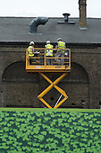 Construction workers on a hoist on the Kings Cross development site, London.