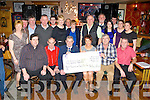 The Anvil bar Walking group from Boolteens who raised €7,025 for the Kerry Hospice/Pallative Care Unit in Kerry General Hospital presented the cheque in the Anvil Bar on Sunday night front row l-r: Seamus O'Connor, James Ashe, Teddy Moynihan, Donal Griffin, Sean Foley. Back row: Kathleen Daly, Donal Daly, Johnny O'Sullivan, Dan Galvin, Johnny Daly, Margaret Clifford, Benny Clifford, Mary Sheehan, Michael O'Sullivan, Pat Shea, Deirdre Cronin, Patrick Cronin,Carina and Elaine Cronin..