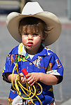 Twenty-two month old Niall learns to rope during the Reno Rodeo Parade on Saturday, June 22, 2019.