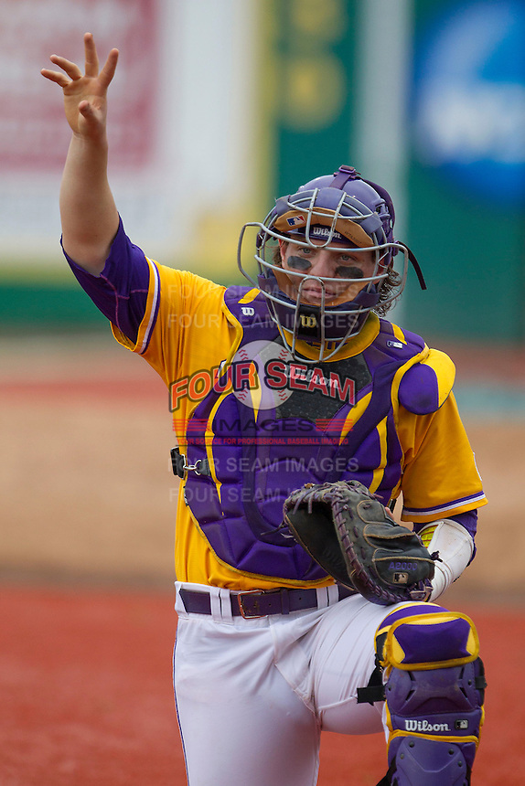 LSU Tigers catcher Kade Scivicque (22) warms up before the Southeastern Conference baseball game against the Texas A&M Aggies on April 25, 2015 at Alex Box Stadium in Baton Rouge, Louisiana. Texas A&M defeated LSU 6-2. (Andrew Woolley/Four Seam Images)