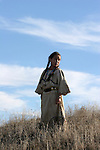 A young Native American Indian girl standing in the prairie of South Dakota