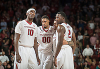 NWA Democrat-Gazette/ANTHONY REYES &bull; @NWATONYR<br /> Arkansas' Bobby Portis, from left, Rashad Madden, Anton Beard, and Alandise Harris huddle up in the closing seconds against Tennessee Tuesday, Jan. 27, 2015 in Bud Walton Arena in Fayetteville. The Razorbacks won 69-64.