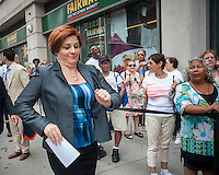 """NYC mayoral candidate and City Council Speak Christine Quinn arrives at Fairway supermarket in the Chelsea neighborhood of New York on its grand opening day, Wednesday, July 24, 2013. The store is the fifth in Manhattan and is an epicurean delight carrying olive oils, cheeses, sushi and their famous deli department. The Chelsea location puts the store in the middle of """"supermarket-ville"""" with Whole Foods, Gristedes and Trader Joe's all having locations in the immediate vicinity.(© Richard B. Levine)"""