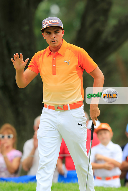 Rickie FOWLER (USA) sinks his putt on the 2nd green during Sunday's Final Round of the 2015 Bridgestone Invitational World Golf Championship held at the Firestone Country Club, Akron, Ohio, United States of America. 9/08/2015.<br /> Picture Eoin Clarke, www.golffile.ie