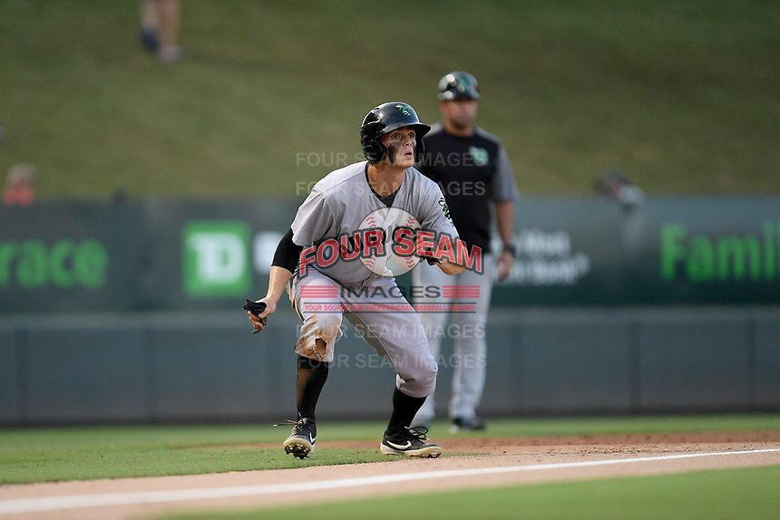 Second baseman Simon Whiteman (10) of the Augusta GreenJackets takea a lead off third base in a game against the Greenville Drive on Thursday, August 29, 2019, at Fluor Field at the West End in Greenville, South Carolina. (Tom Priddy/Four Seam Images)