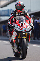 Michel Fabrizio (ITA) riding the Aprilia RSV4 1000 Factory (84) of the Red Devils Roma team leaving the pits for a practise session on day one of round one of the 2013 FIM World Superbike Championship at Phillip Island, Australia.