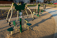 A wide-angle view of some of the Greenfields outdoor bodyweight exercise equipment at State Street Park just before sunset.