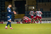 30th November 2019; Dens Park, Dundee, Scotland; Scottish Championship Football, Dundee Football Club versus Queen of the South; Stephen Dobbie of Queen of the South is mobbed by team mates after scoring for 2-1 in the 93rd minute - Editorial Use