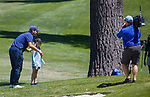 Tony Romo with a young fan during the ACC Golf Tournament at Edgewood Tahoe Golf Course in South Lake Tahoe on Sunday, July 14, 2019.