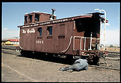 D&amp;RGW caboose #0503 being inspected.<br /> D&amp;RGW  Alamosa, NM  Taken by Berkstresser, George