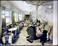 BNPS.co.uk (01202 558833)<br /> Pic:    CanterburyAuctionGalleries/BNPS<br /> <br /> A children's playroom.<br /> <br /> Remarkable photos of the iconic ocean liner SS Normandie which was like a 'floating palace' have come to light over 80 years later.<br /> <br /> The giant 1,000ft long French passenger ship was the largest of her type in the world and won the coveted 'Blue Riband' for the fastest crossing of the Atlantic.<br /> <br /> English photographer Percy Byron's photos show the liner's luxurious 'Art Deco' interior with its chandeliers and pillars of Lalique glass.<br /> <br /> The vessel, which launched in 1935, even boasted its own swimming pool and a gym where young women can be seen doing aerobics while a man in a suit trains with a punch bag.