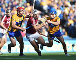 Daithi Burke of Galway in action against John Conlon and Shane O Donnell of Clare during their All-Ireland semi-final at Croke Park. Photograph by John Kelly.
