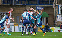 Adebayo Akinfenwa of Wycombe Wanderers celebrates his goal with teammates during the Sky Bet League 2 match between Wycombe Wanderers and Crawley Town at Adams Park, High Wycombe, England on 25 February 2017. Photo by Andy Rowland / PRiME Media Images.