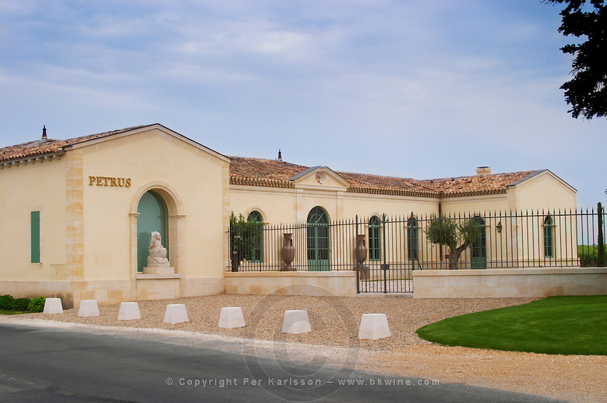 The newly renovated Chateau Petrus with iron fence and gate and a statue of Peter the apostle Pomerol Bordeaux Gironde Aquitaine France