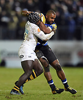 Aled Brew of Bath Rugby is tackled by Christian Wade of Wasps. Aviva Premiership match, between Bath Rugby and Wasps on December 29, 2017 at the Recreation Ground in Bath, England. Photo by: Patrick Khachfe / Onside Images
