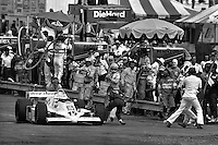 Bobby Rahal is safely out of his car in the pit lane after a fire started following a pit stop in the 1982 IndyCar race at Phoenix International Raceway near Phoenix, Arizona.