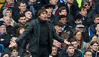 Chelsea manager Antonio Conte shrugs his shoulders during the Premier League match between Chelsea and Tottenham Hotspur at Stamford Bridge, London, England on 1 April 2018. Photo by Andy Rowland.