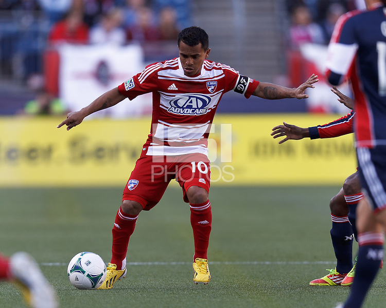 FC Dallas midfielder David Ferreira (10) dribbles at midfield. .  In a Major League Soccer (MLS) match, FC Dallas (red) defeated the New England Revolution (blue), 1-0, at Gillette Stadium on March 30, 2013.