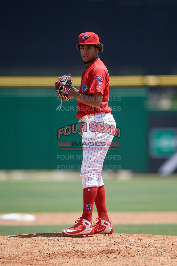 Clearwater Threshers starting pitcher Adonis Medina (18) gets ready to deliver a pitch during a game against the Lakeland Flying Tigers on May 2, 2018 at Spectrum Field in Clearwater, Florida.  Clearwater defeated Lakeland 7-5.  (Mike Janes/Four Seam Images)