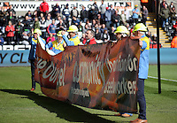 Tata Port Talbot steel workers with a support banner before the Barclays Premier League match between Swansea City and Chelsea at the Liberty Stadium, Swansea on April 9th 2016
