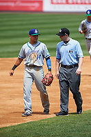 Hartford Yard Goats second baseman Anthony Phillips (14) talks with umpire Randy Rosenberg in between innings during a game against the Binghamton Rumble Ponies on July 9, 2017 at NYSEG Stadium in Binghamton, New York.  Hartford defeated Binghamton 7-3.  (Mike Janes/Four Seam Images)