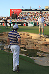 Rory McIlroy's caddy advises where to drop after his 3rd shot ends up in the stream at the 18th green during  Day 3 at the Dubai World Championship Golf in Jumeirah, Earth Course, Golf Estates, Dubai  UAE, 21st November 2009 (Photo by Eoin Clarke/GOLFFILE)